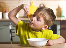 Child eating breakfast Stock Photo