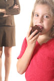 Child eating brownie - mom not Stock Photography