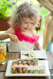 Child eating in cafe Stock Photos