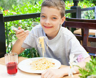 Child eating at cafe Stock Images