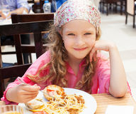Child eating at cafe Royalty Free Stock Images