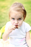 Child eating cake Royalty Free Stock Image