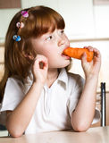 Child eating carrot Stock Image
