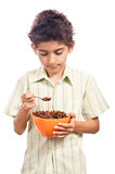 Child eating cereals Stock Photography
