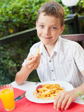 Child eating chips Stock Photo