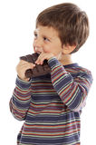 Child eating chocolate Stock Photography