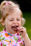 Child eating chocolate Stock Photos