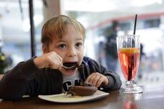 Child eating chocolate cake Stock Image