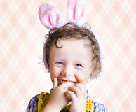 Child Eating Chocolate Easter Egg With Smile Stock Photos
