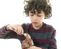 Child eating chocolate icecream Stock Photography