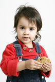Child eating cookie Stock Image