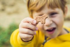 Child Eating Cookie On The Nature Background stock photos