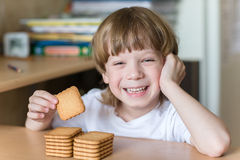 Child eating cookies Stock Image
