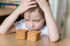Child eating cookies Royalty Free Stock Image
