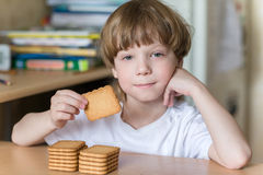 Child eating cookies Stock Photography
