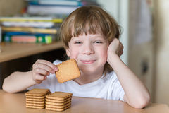 Child eating cookies Stock Photo