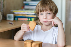 Child eating cookies Royalty Free Stock Photos