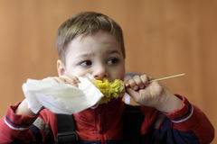 Child eating corn Royalty Free Stock Photography