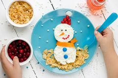 Child eating cottage cheese snowman stock images