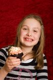 Child eating a cupcake Royalty Free Stock Photography