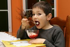 Child eating dessert Royalty Free Stock Photos