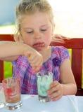 Child is eating dessert Stock Photos