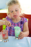 Child is eating dessert Stock Photography