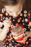 Child eating dessert Stock Photography