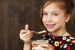 Child eating dessert Stock Image