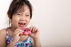 Child Eating Donut / Child Eating Donut Background Royalty Free Stock Image