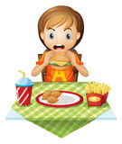 A child eating at a fastfood restaurant Stock Illustration