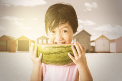 Child eating a fresh watermelon Royalty Free Stock Photography