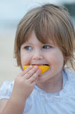 Child eating fruit Stock Images