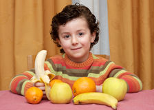 Child eating fruit Stock Photos