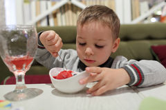 Child eating fruit ice cream Stock Photography