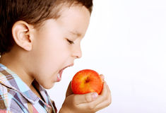 Child eating healthy Stock Photos