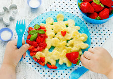 Child eating healthy and delicious Christmas breakfast gingerbre Royalty Free Stock Photo