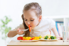 Child eating healthy food at home Royalty Free Stock Photography
