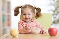 Child eating healthy food at home or kindergarten Stock Photos