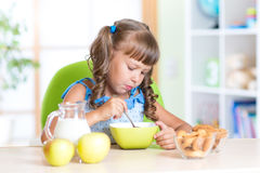 Child eating healthy food in nursery Royalty Free Stock Photo