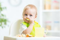 Child eating healthy food Stock Image