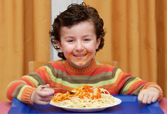 Child eating in his house Royalty Free Stock Image