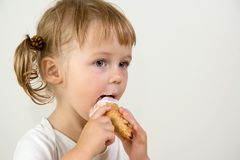 Child eating ice cream. Young girl eating tasty ice cream Royalty Free Stock Photo