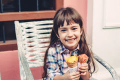 Child eating ice cream in the city street Royalty Free Stock Images