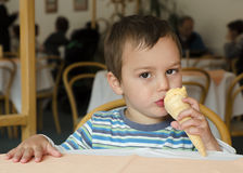 Child eating ice cream Royalty Free Stock Images