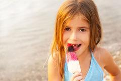 Child eating ice cream Stock Image