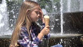 Child Eating Ice Cream Outdoor in Park, Girl Relaxing by a Fountain in Summer 4K stock video