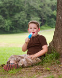Child eating ice cream treat outdoors Royalty Free Stock Photos