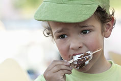 Child eating an icecream. A boy eating an icecream outdoor Royalty Free Stock Photo
