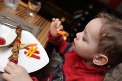 Child eating kebab Stock Photos